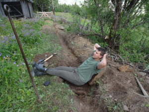 We (Quinn and Myself) dug a ditch to expand the chicken coop.  The soil is rather stony, this particular boulder split perfectly in two which was rather convenient - a nice cool down from a long days work.
