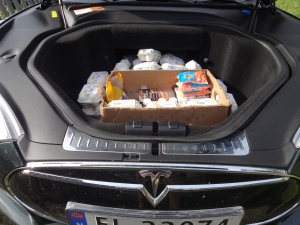 A friend of Dan's came bearing gifts - in his Tesla Model S! I asked to see the engine and Carl opened up the hood to reveal this treasure - eggs and bacon! The motor is actually located in the wheel hubs, making more room for interesting goodies.