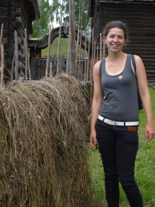 Kim standing next to a hayrack at the folk museum. No where near as expert as our hay-racks on the farm however.