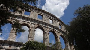 Roman Arena in Pula, the massive stone structure dominates the landscape. I stared up in awe for way too long, oblivious to the world and just awe-struck by the vastness of the edifice.