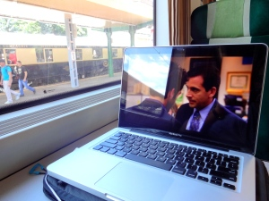 """Watching The Office aboard a train from Bucharest to Brasov on my way to my host's location. The train in background is the famous """"Oriental Express,"""" which is basically like the Harry Potter train with luxury sleeping cars, dining cars, and an actual old-style engine. Pretty amazing to see, though the waiting list is quite extensive."""